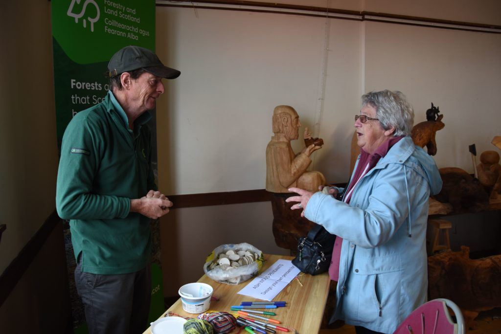 Bob Logan, wildlife ranger for the Forestry Commission speaks to a visitor about forests on Arran.