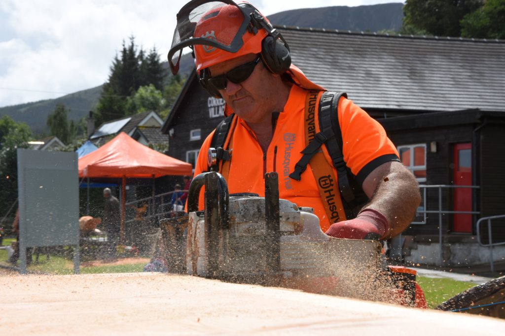 Mark Bunyan milled a large Douglas fir tree and spoke to visitors explaining the process.
