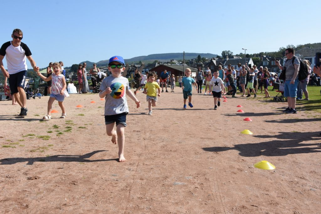 Children enjoy the friendly competition, and sweet rewards, of the children's under four race.
