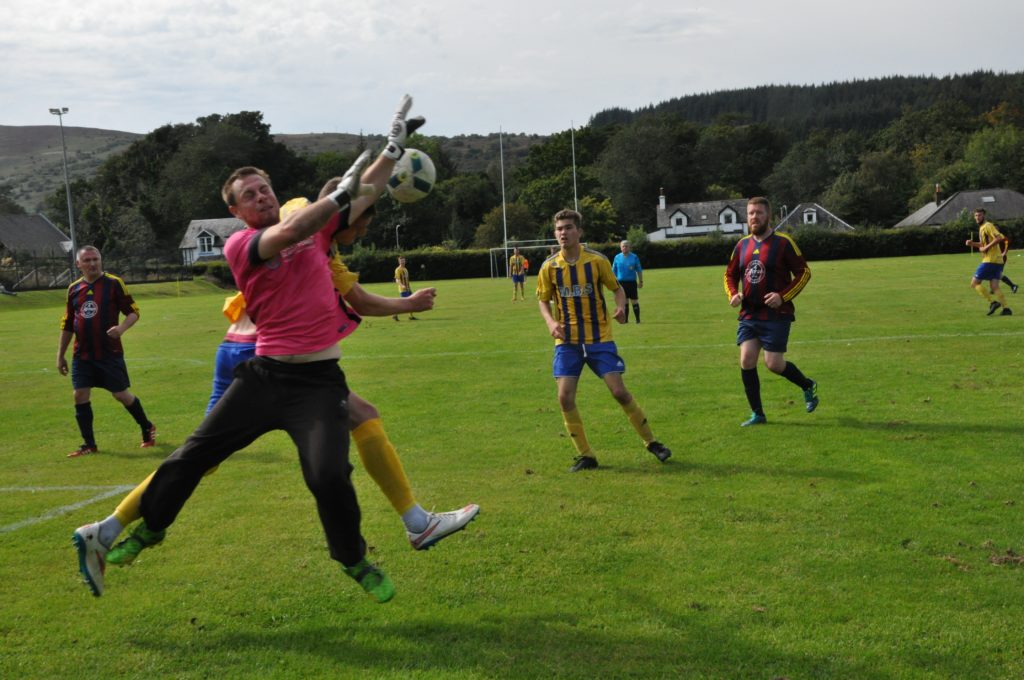 Northend keeper Stuart Lawson is first to the ball.