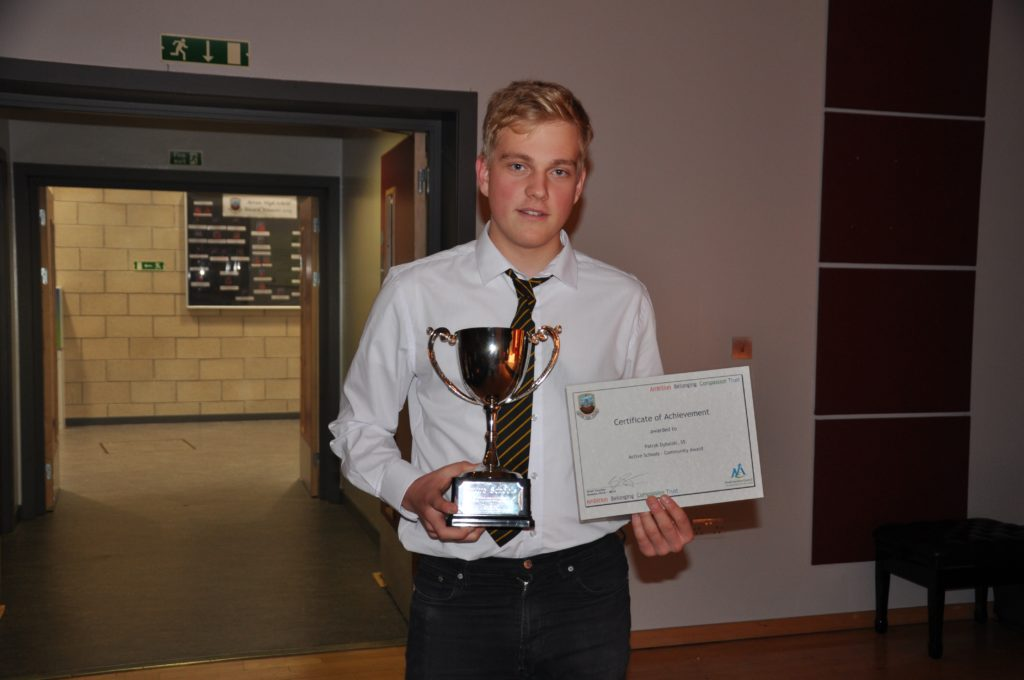 Patryk Dybalski with his active schools community award.