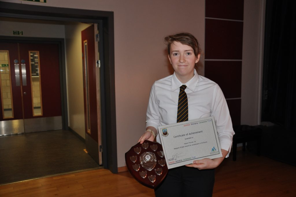 Naomi Provan with the Margaret Wright Shield for achievement in S4 exams.