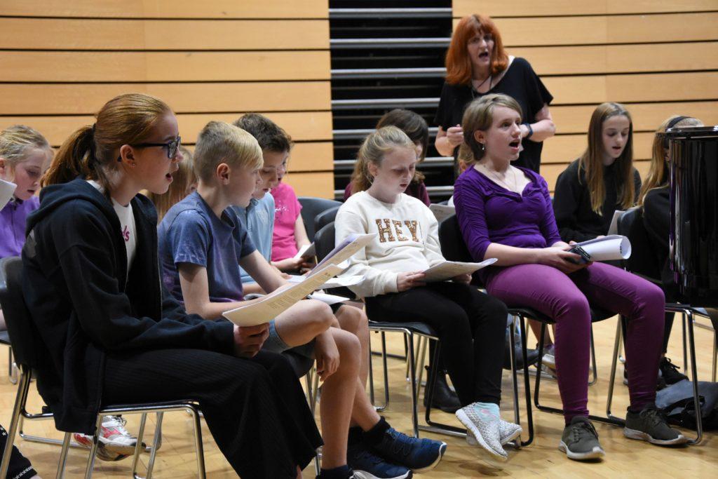 In full voice choir members sing familiar songs.