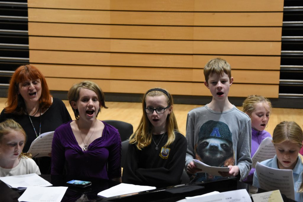 Members sing along to popular songs without the need for the words in the songbook.