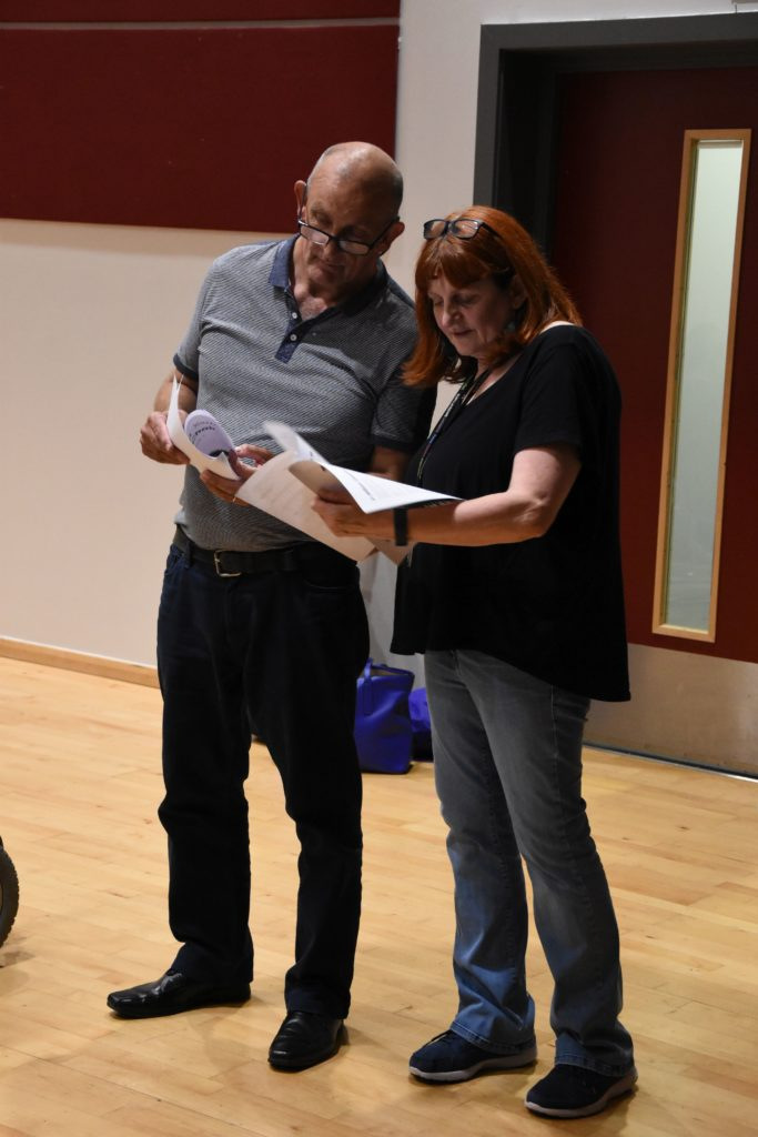 Michael Gettings and Moyra Manson familiarise themselves with some of the song lyrics.
