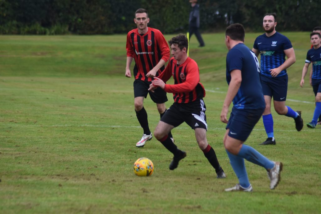 Johnny Sloss weaves his way through opposition players to score for Arran.