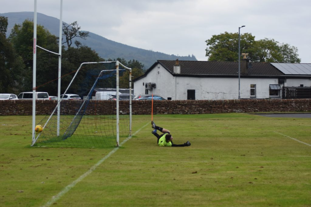The Blantyre keeper is unable to stop a powerful kick from Archie McNicol.