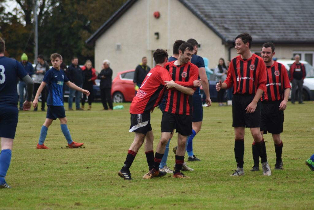 Teammates congratulate Archie McNicol after his second goal.