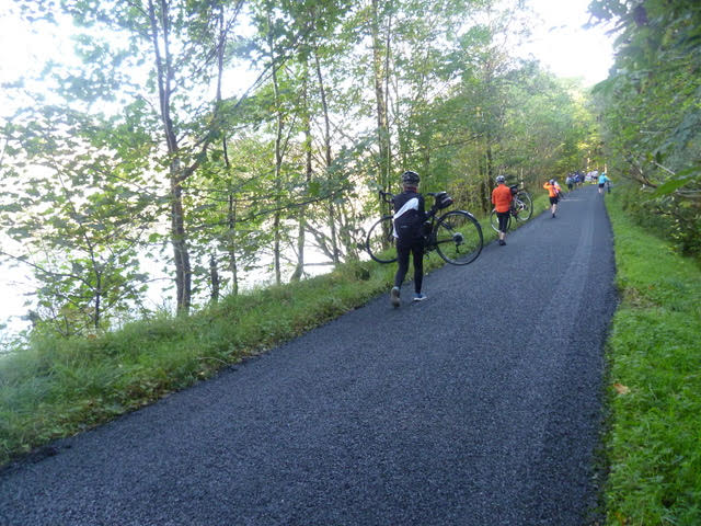 Not their usual means of travel, the Belles carry their bikes along a freshly tarred road at Loch Awe.