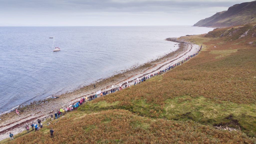Protestors line the length of the bay illustrating a small portion of the shoreline than will directly overlook the proposed development. Photograph: James Appleton.