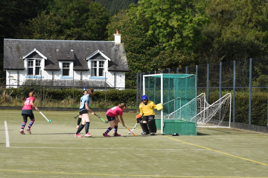 Mia Walker's attempt at goal is deflected by the Troon keeper.