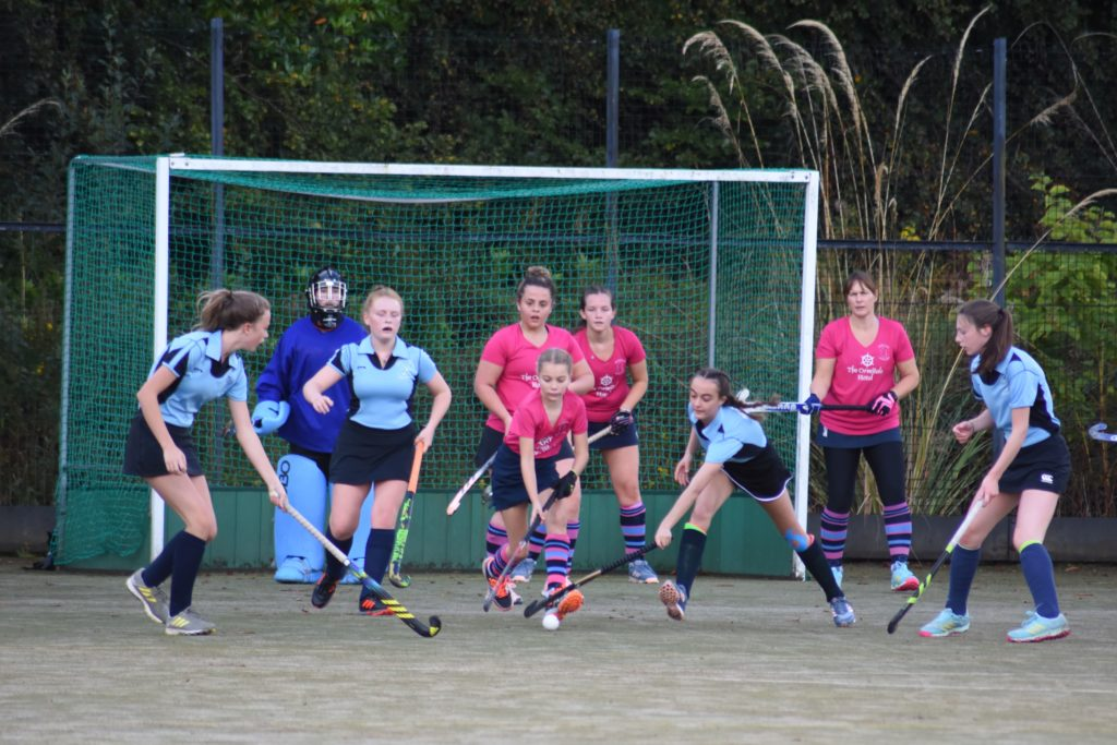 Dame of the game Annie McKelvie removes the ball from her defensive D despite tough opposition from Troon.