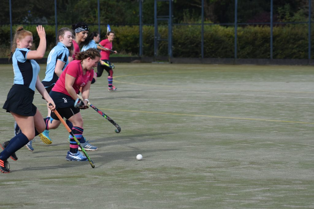 Jenny Stark surges ahead and claims possession of the ball.