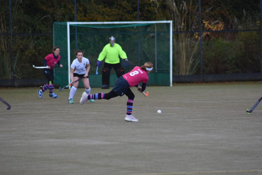 Susie Murchie blasts the ball towards an awaiting Lorraine Hewie.
