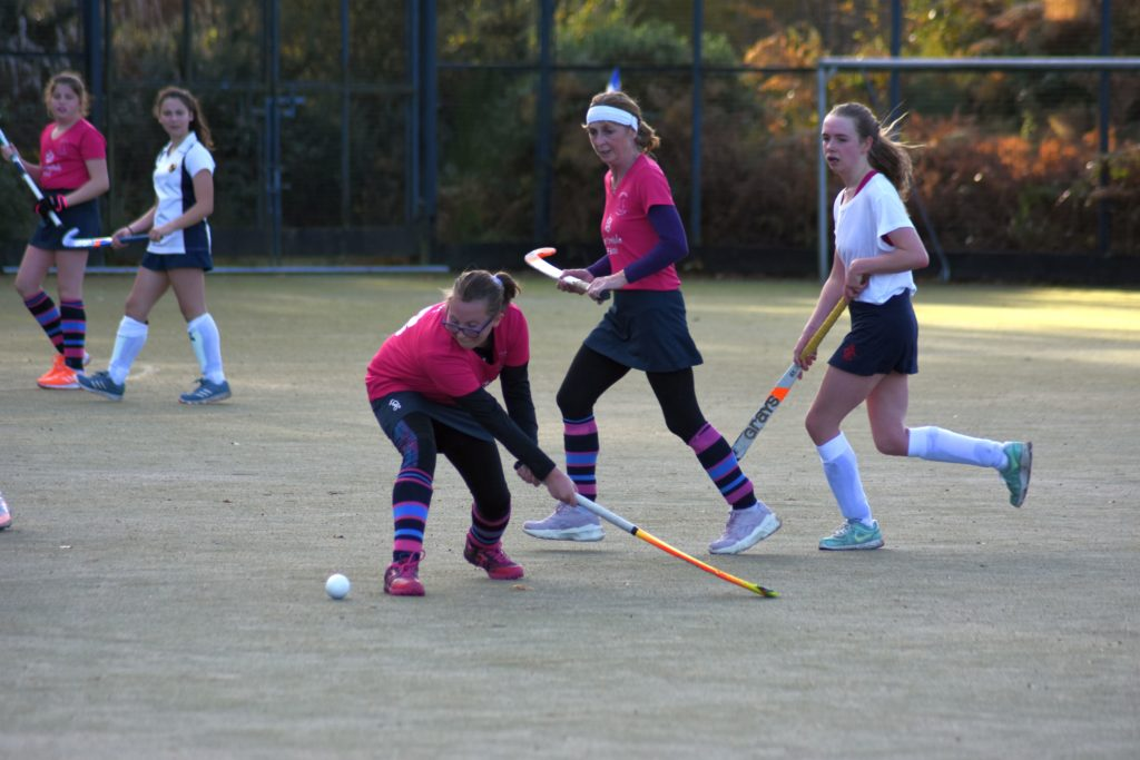 Mia Walker in centre mid position blasts the ball down the field towards the forwards.