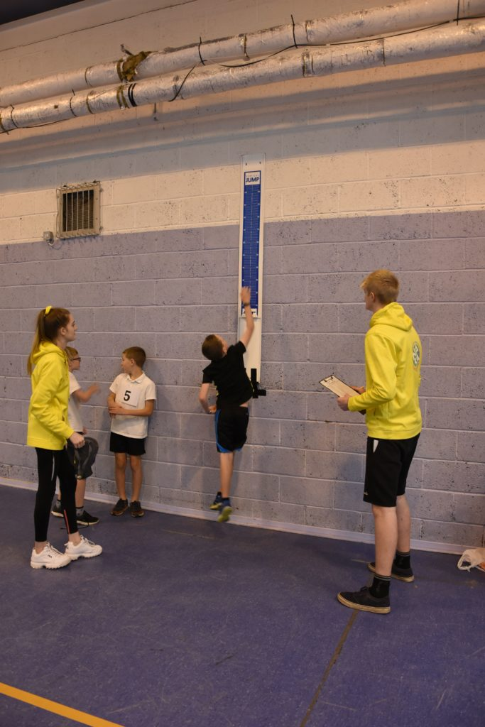 A pupil launches himself in the air during the vertical jump.