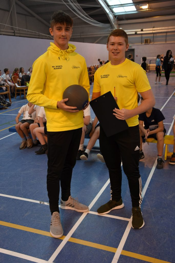 North Ayrshire Sports Academy volunteers, James Reid and Jed Russell run the chest throw event.