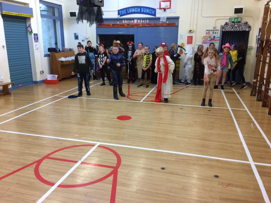 P5 to P7 pupils at Brodick Primary School play Hallowe'en games.
