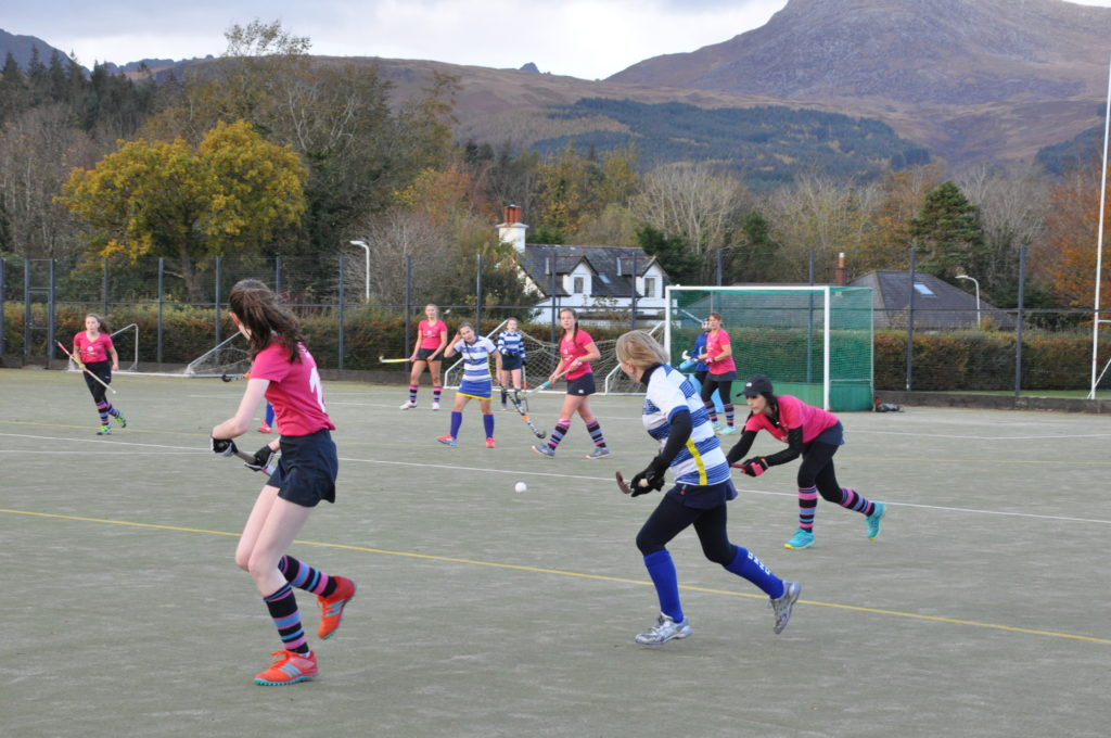 Anne Watts clears from a crowded penalty area.