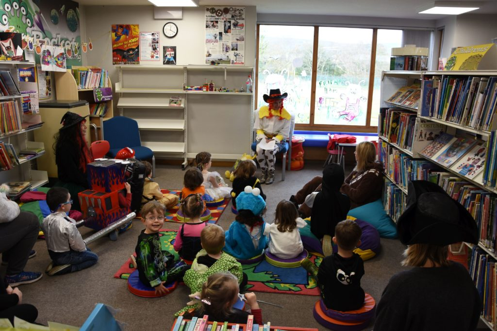 Brodick Nursery pupils listen to a scary story at Brodick Library's Bookbug meeting.