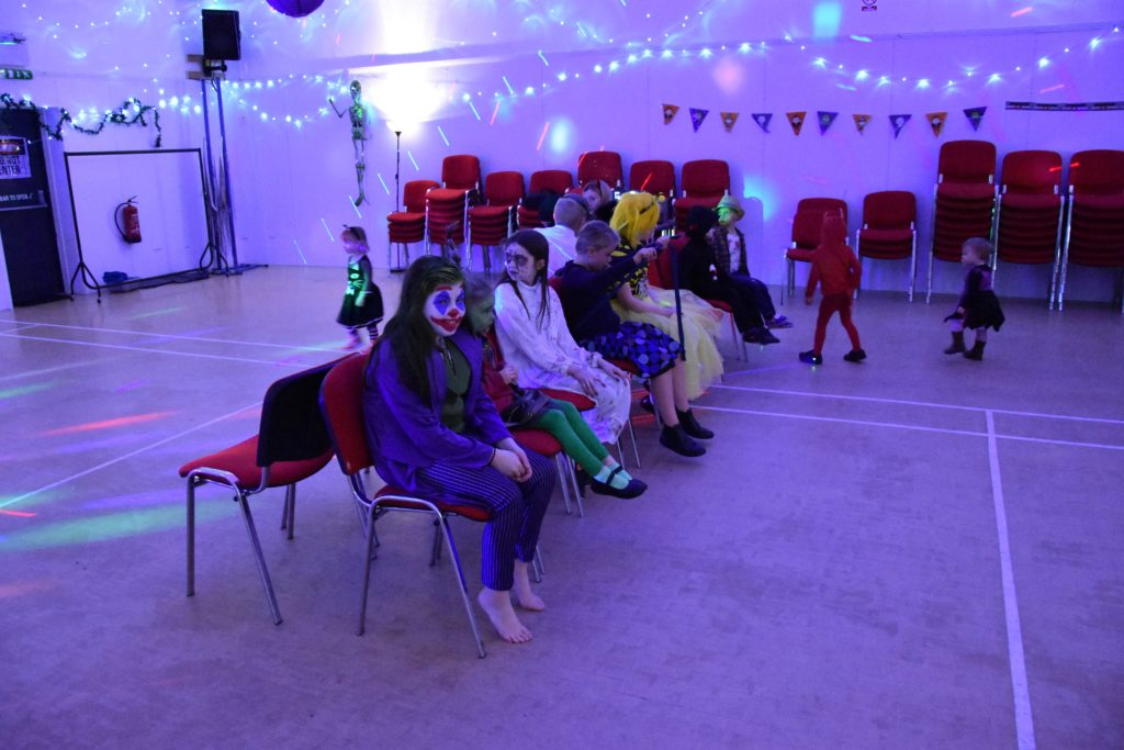 Children enjoy a lively game of musical chairs at Lochranza.