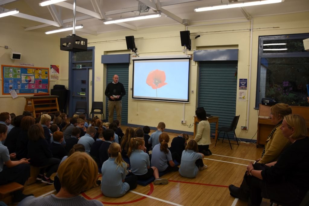 Rev Angus Adamson speaks to the school pupils about the importance of remembrance during a special remembrance assembly.