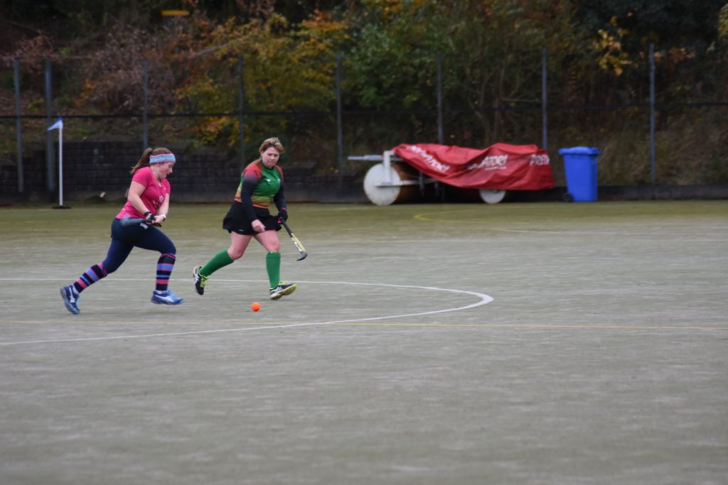 Jenny Stark runs at full speed to secure the ball and pass it to her forward players.