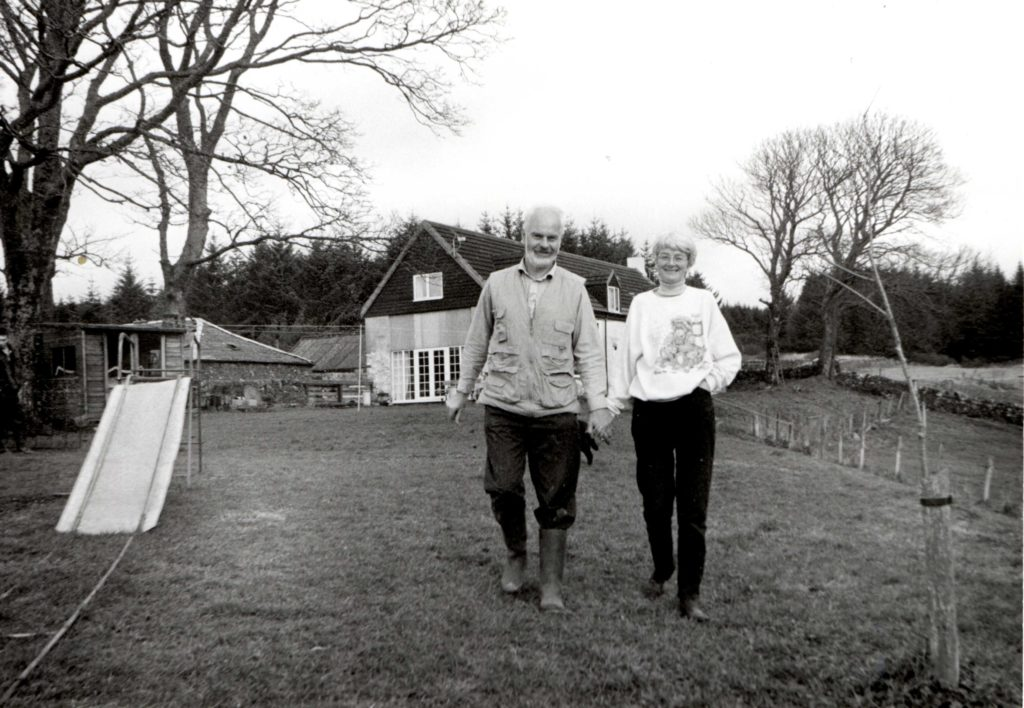Peter and Pat Gedees, who have been in a year long dispute with BT to secure a reliable telephone service, are pictured outside their newly renovated home which they have built up from a burnt out shell at Auchareoch.