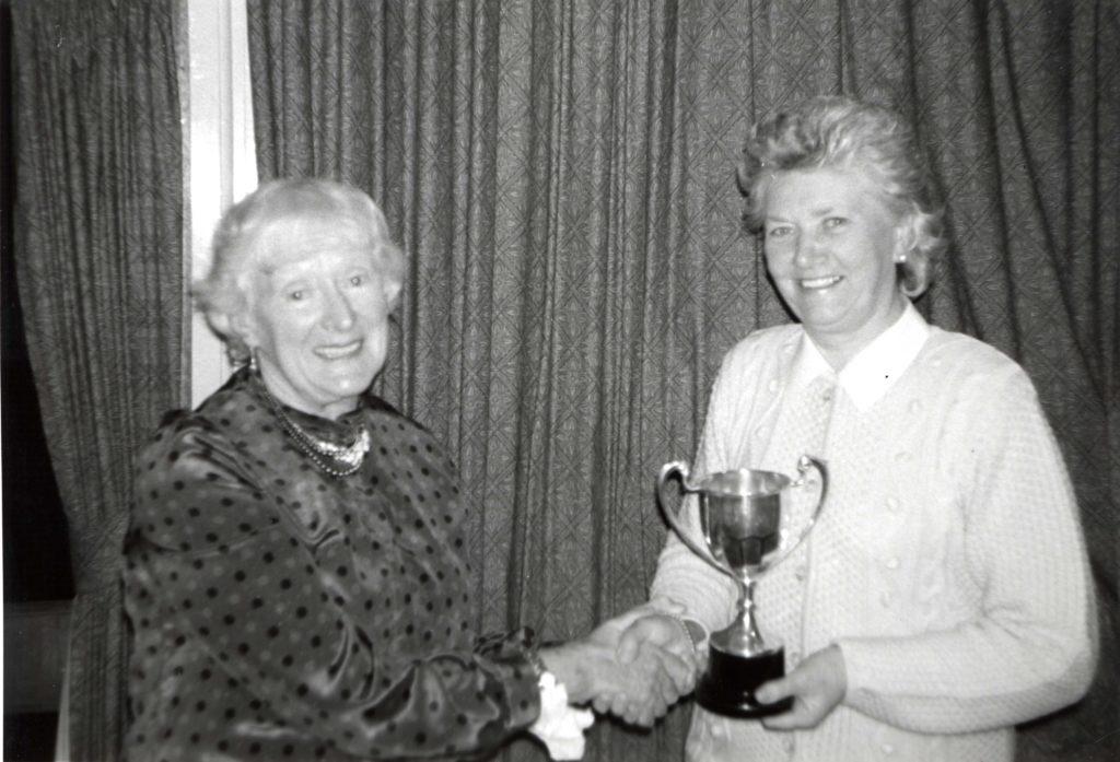 Past captain of Lamlash Ladies Golf Club, Joy Elliot presents Ellie Jones with the Championship Trophy at the club's prizegiving dinner.