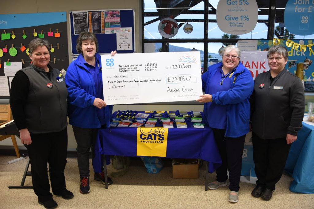 Linda Hartley and Kay McWilliam of Cats Protection proudly show off their cheque with Liz McLean and Carol Harwood.