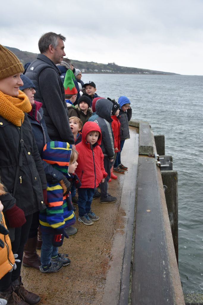 Children brave the cold of Lamlash Pier to catch a glimpse of Santa who arrived by boat.