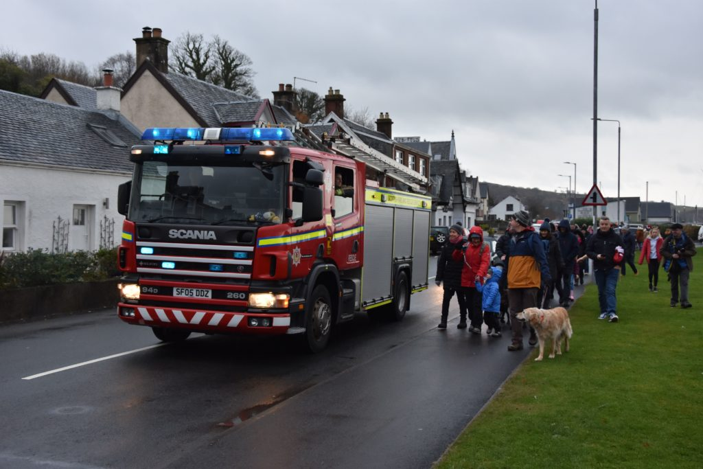 Emergency vehicles join the parade as the crowds make their way to the Sparkle venue.