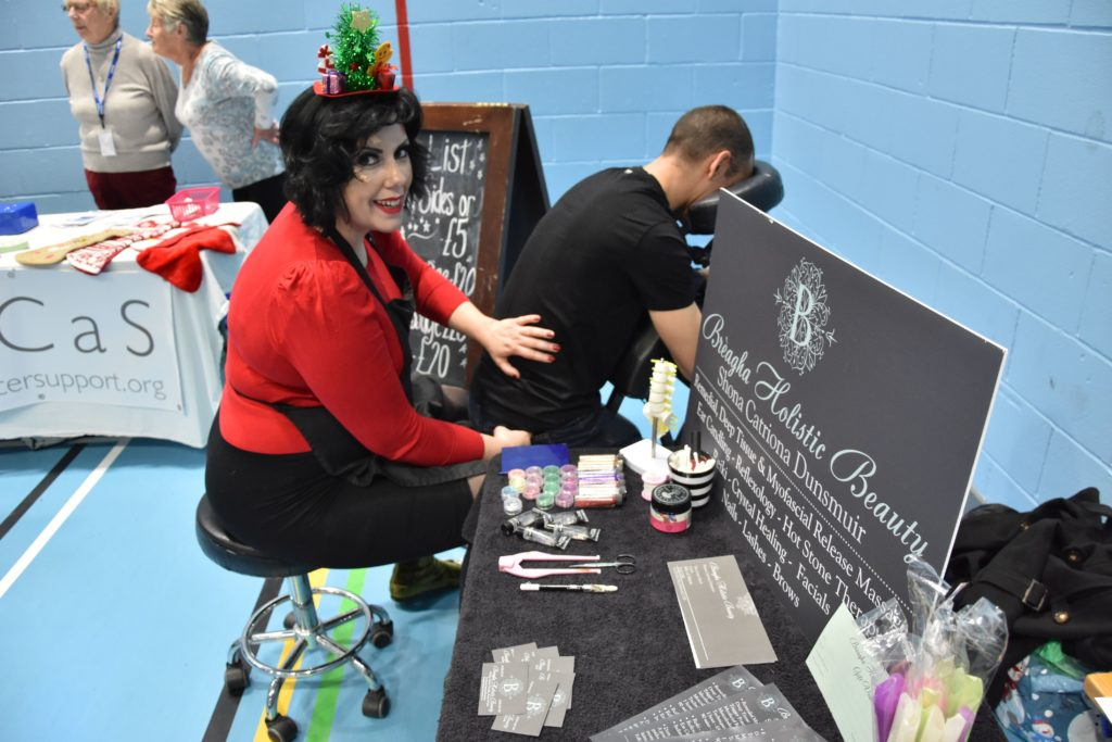 Shona Catriona Dunsmuir of Breagha Holistic Beauty works her magic on a patient with a sore back.