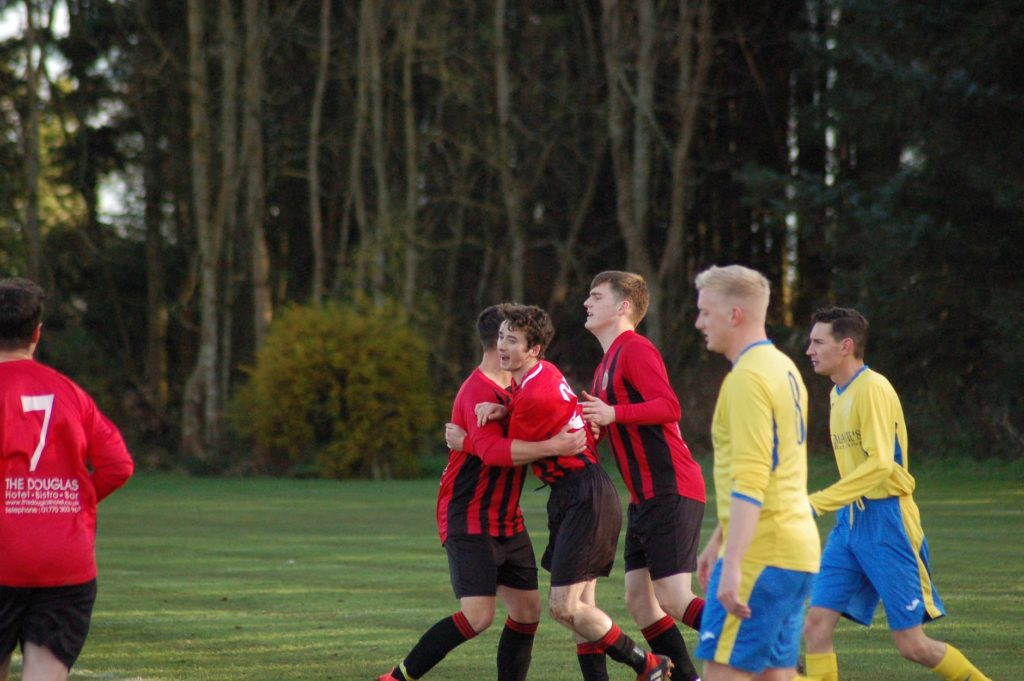Johnny Sloss is congratulated by his team mates after threading the ball into the goal right in front of the Glencairn keeper.