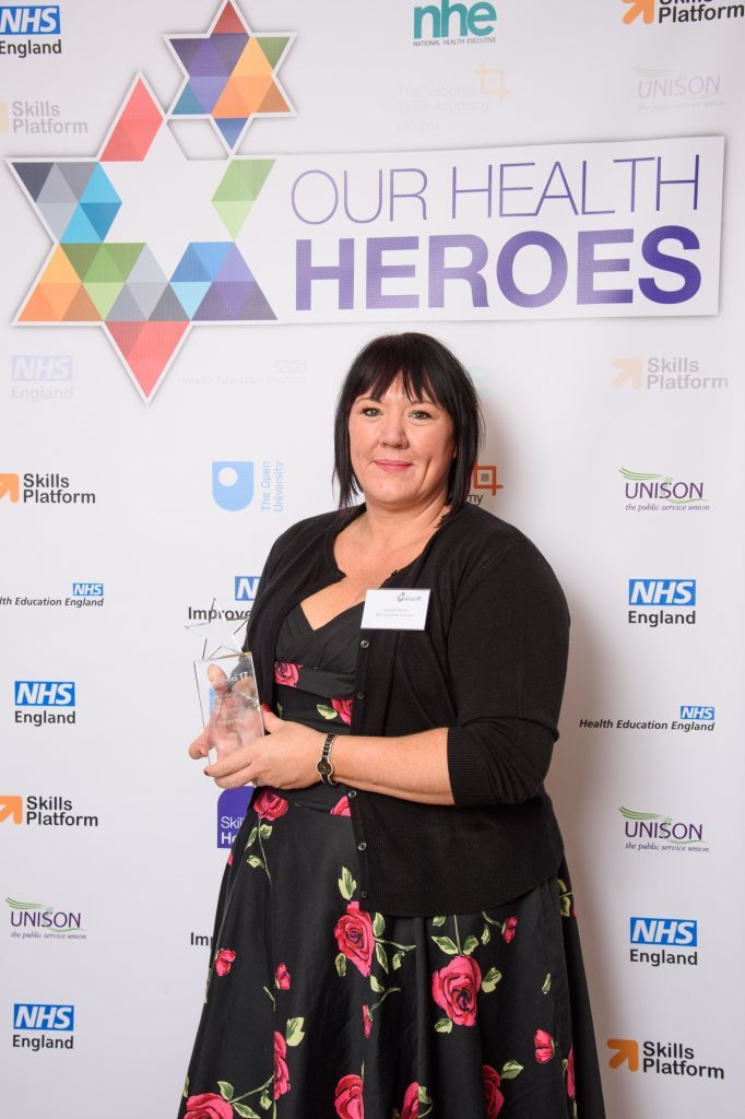 Health hero Yvonne lifts her prestigious award
