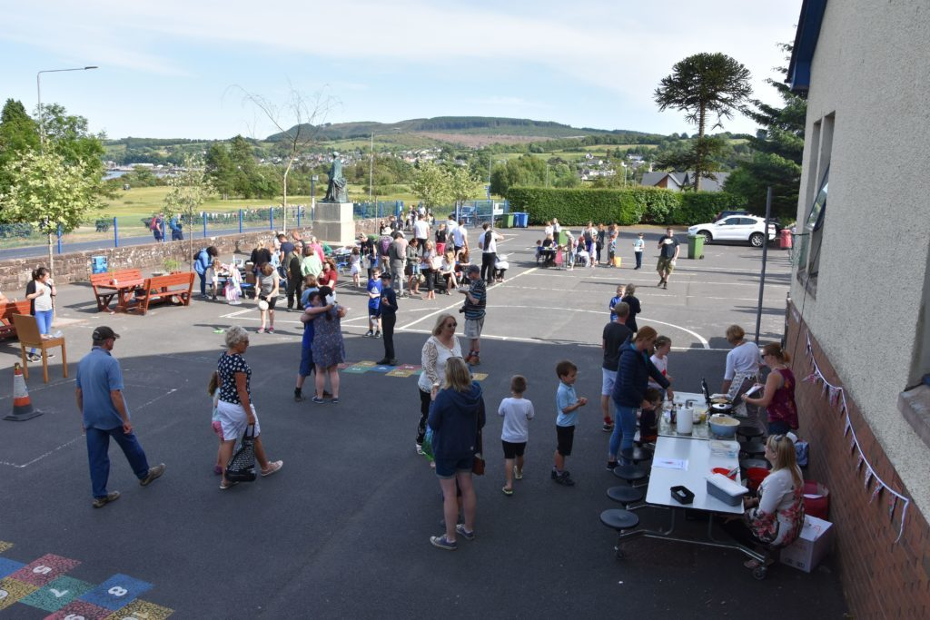 Summer sunshine draws the crowds at school fair